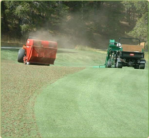 Red and Green soil machines grooming golf course